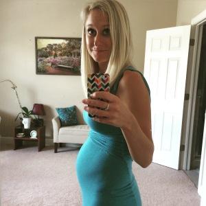 Baby bump photo at 15 weeks pregnant.