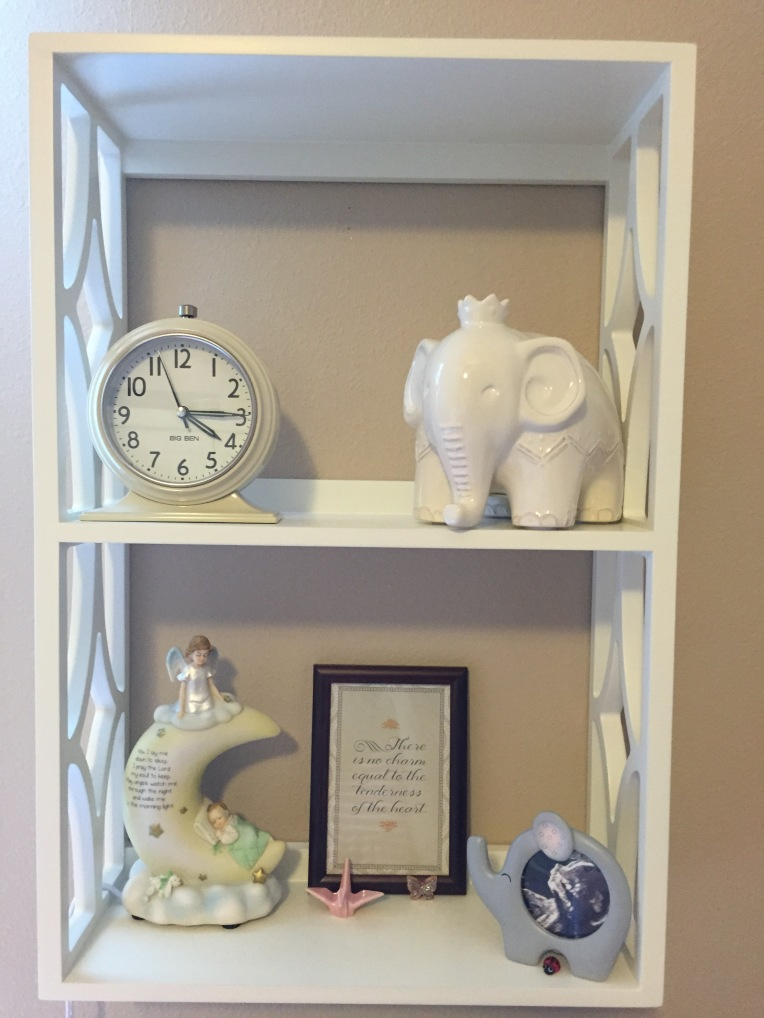This shelf has a framed Jane Austen quote, a crane and butterfly (I've always loved cranes and butterflies), a tiny ladybug my dad bought me last year for good luck, a photo of Madelyn at 18 weeks, and a nightlight that my dad and stepmom bought for Madelyn.