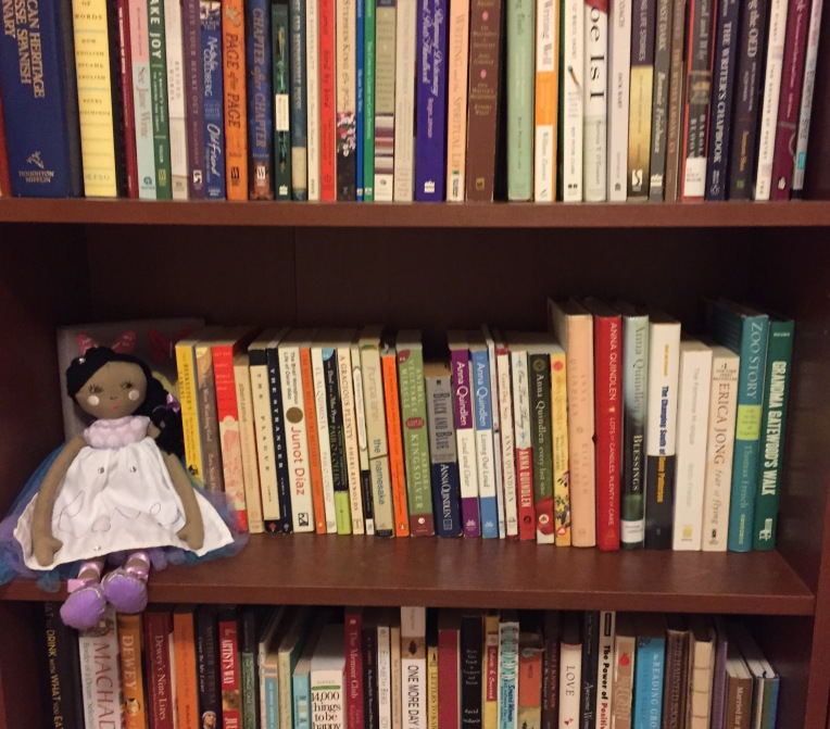 Madelyn's nursery is full of books. This past weekend, I bought her a doll (her first one!) and found a spot for her on one of the bookshelves.