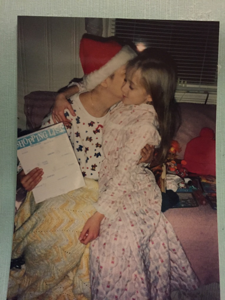 I love this photo, which I recently came across. This was my mom's last Christmas, two months before she died. I look so happy to be in her arms!